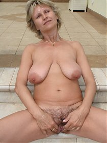 Hot older MILF with wildly bushy cunt takes a cock pounding!
