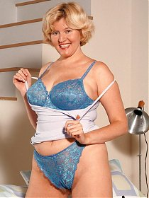 Hot solo scene with a mature blonde stripping off her undies to flaunt her hairy box